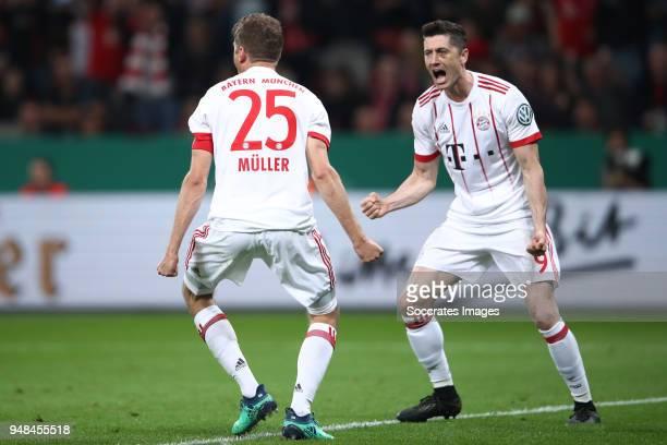 Thomas Mueller of Muenchen celebrates a goal with team mate Robert Lewandowski during the DFB Cup semi final match between Bayer 04 Leverkusen and...