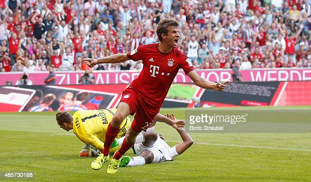 Thomas Mueller of Muenchen celebrates after scoring his team's first goal during the Bundesliga match between FC Bayern Muenchen and Bayer 04...