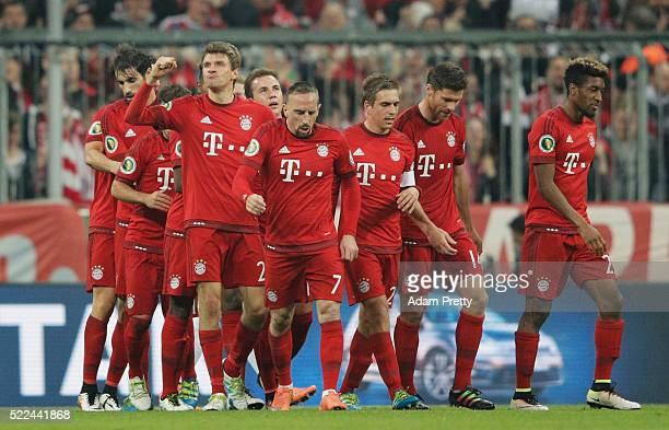 Thomas Mueller of Muenchen celebrates after scoring his teams first goal during the DFB Cup semi final match between FC Bayern Muenchen and Werder...