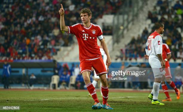 Thomas Mueller of Muenchen celebrates after scoring his teams fourth goal during the friendly match between Kuwait SC and Bayern Muenchen at Kuwait...