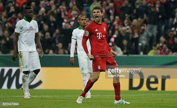 Thomas Mueller of Muenchen celebrates after scoring his teams second goal during the DFB Cup semi final match between FC Bayern Muenchen and Werder...