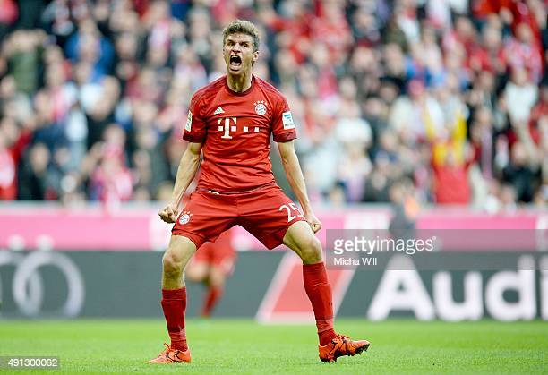 Thomas Mueller of Muenchen celebrates after scoring the opening/first goal during the Bundesliga match between FC Bayern Muenchen and Borussia...