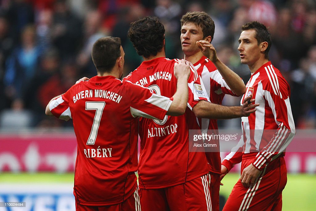 Thomas Mueller (2R) of Muenchen celebrates his team's fifth goal with team mates Franck Ribery, Hamit Altintop and Miroslav Klose (L-R) during the Bundesliga match between FC Bayern Muenchen and Hamburger SV at Allianz Arena on March 12, 2011 in Munich, Germany.