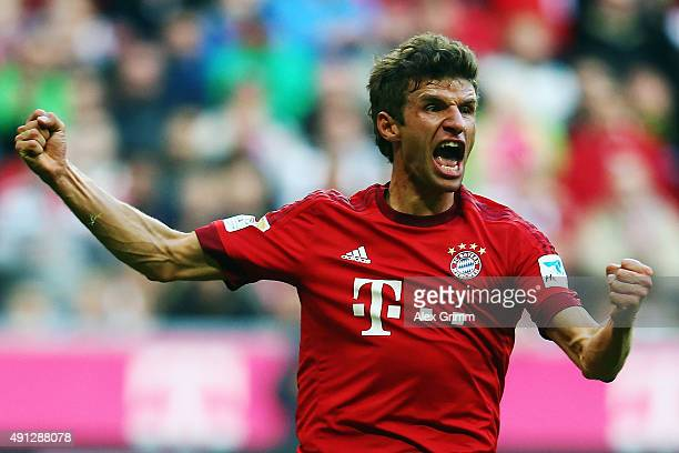 Thomas Mueller of Muenchen celebrates his team's first goal during the Bundesliga match between FC Bayern Muenchen and Borussia Dortmund at Allianz...