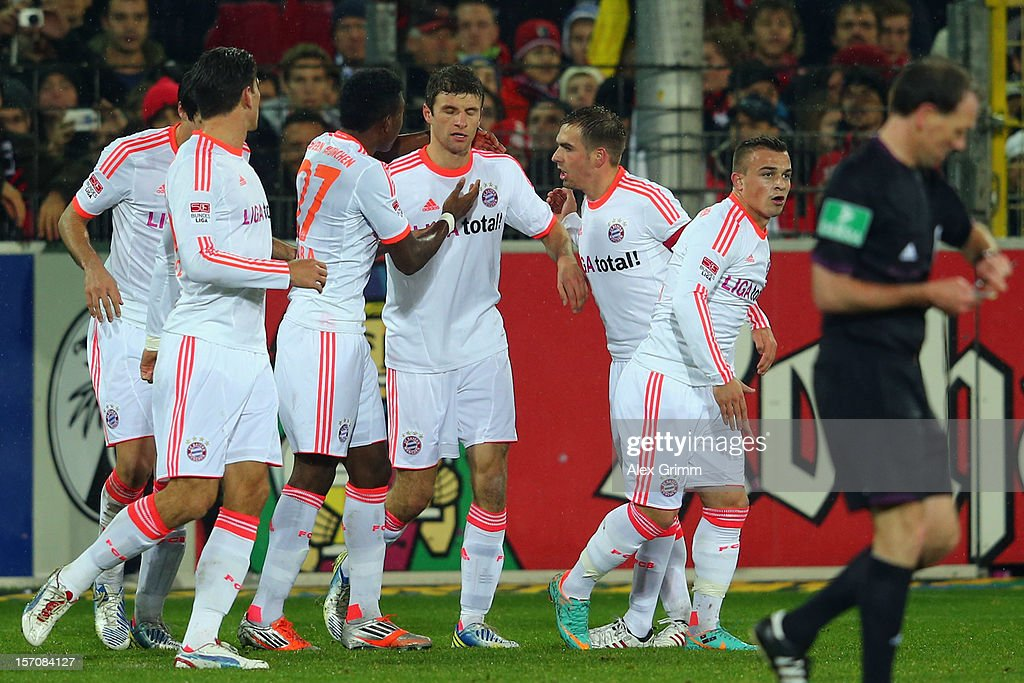 Thomas Mueller of Muenchen celebrates his team's first goal with team mates during the Bundesliga match between SC Freiburg and FC Bayern Muenchen at MAGE SOLAR Stadium on November 28, 2012 in Freiburg im Breisgau, Germany.