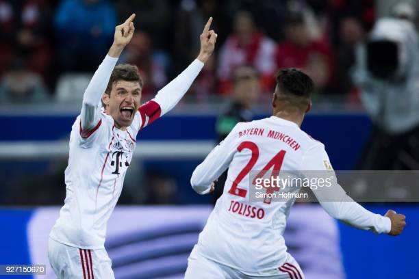 Thomas Mueller of Muenchen celebrates his team's first goal with team mate Corentin Tolisso during the Bundesliga match between SportClub Freiburg...