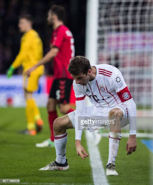 Thomas Mueller of Muenchen celebrates his team's fourth goal during the Bundesliga match between Sport-Club Freiburg and FC Bayern Muenchen at...
