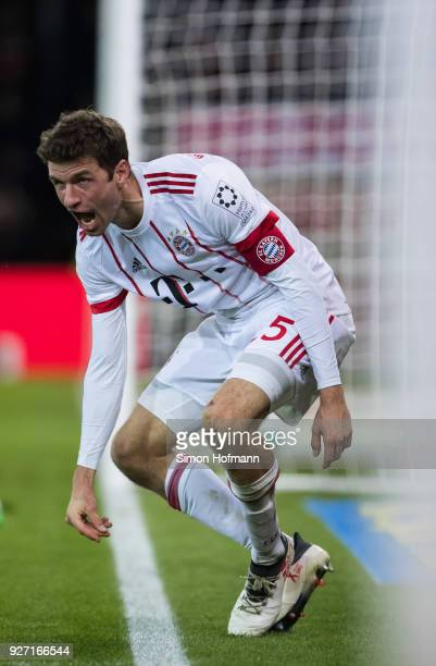 Thomas Mueller of Muenchen celebrates his team's fourth goal during the Bundesliga match between SportClub Freiburg and FC Bayern Muenchen at...