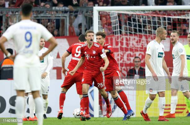 Thomas Mueller of Muenchen celebrates his team's second goal during the DFB Cup quarterfinal match between Bayern Muenchen and 1. FC Heidenheim at...