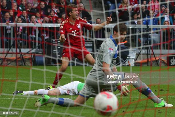 Thomas Mueller of Muenchen celebrates scoring the first team goal against Fabian Giefer keeper of Duesseldorf during the Bundesliga match between FC...