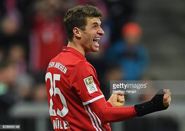 Thomas Mueller of Muenchen celebrates scoring the fourth goal during the Bundesliga match between Bayern Muenchen and VfL Wolfsburg at Allianz Arena...