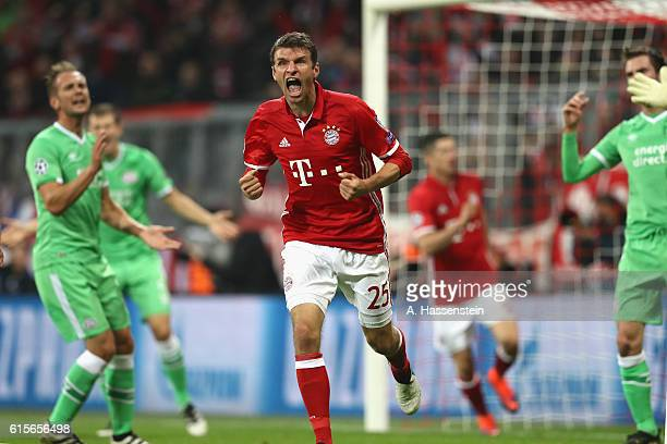 Thomas Mueller of Muenchen celebrates scoring the opening goal during the UEFA Champions League group D match between FC Bayern Muenchen and PSV...