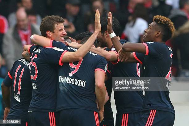 Thomas Mueller of Muenchen celebrates the 3rd team goal with his team mates during the Bundesliga match between VfB Stuttgart and FC Bayern Muenchen...