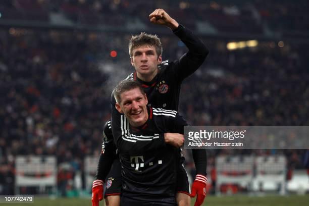 Thomas Mueller of Muenchen celebrates with his etam mate Bastian Schweinsteiger after winning the DFB Cup last 16 match between VfB Stuttgart and FC...