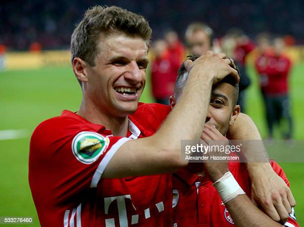 Thomas Mueller of Muenchen celebrates with Thiago of Muenchen after winning the DFB Cup Final 2016 between Bayern Muenchen and Borussia Dortmund at...