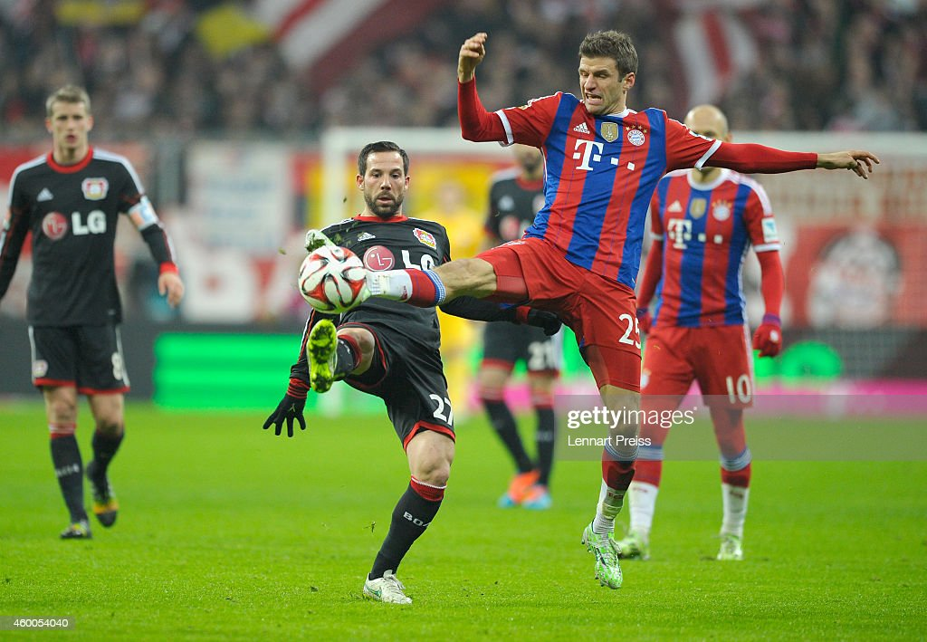 Thomas Mueller (R) of Muenchen challenges Gonzalo Castro (C) of Leverkusen during the Bundesliga match between FC Bayern Muenchen and Bayer 04 Leverkusen at Allianz Arena on December 6, 2014 in Munich, Germany.