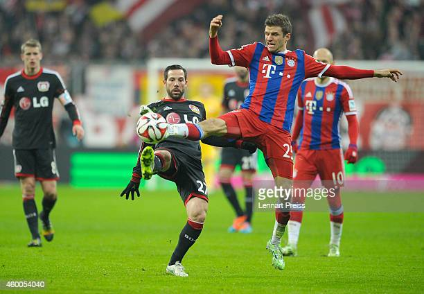 Thomas Mueller of Muenchen challenges Gonzalo Castro of Leverkusen during the Bundesliga match between FC Bayern Muenchen and Bayer 04 Leverkusen at...