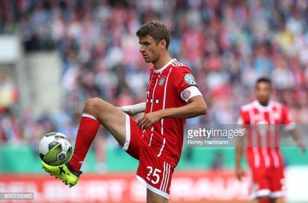 Thomas Mueller of Muenchen controls the ball during the DFB Cup first round match between Chemnitzer FC and FC Bayern Muenchen at community4you Arena...