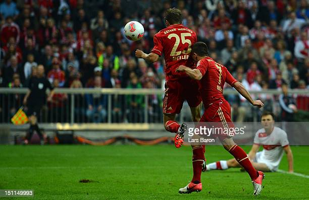 Thomas Mueller of Muenchen heads his teams fifth goal next to team mate Franck Ribery during the Bundesliga match between FC Bayern Muenchen and VfB...