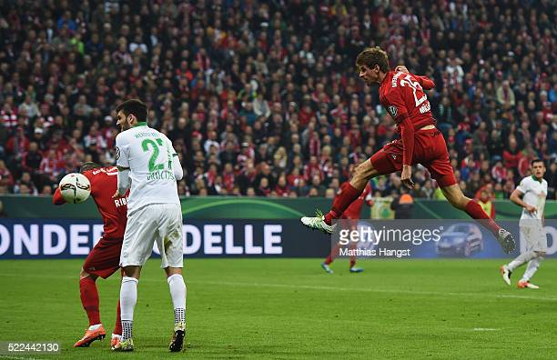 Thomas Mueller of Muenchen heads his teams first goal during the DFB Cup semi final match between FC Bayern Muenchen and Werder Bremen on April 19...