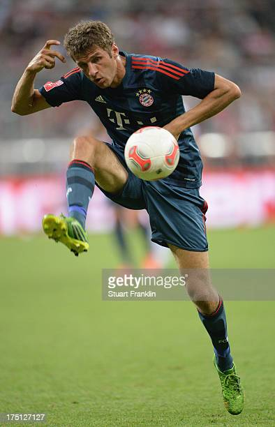 Thomas Mueller of Muenchen in action during the Audi cup match between FC Bayern Muenchen and FC Sao Paulo at Allianz Arena on July 31, 2013 in...