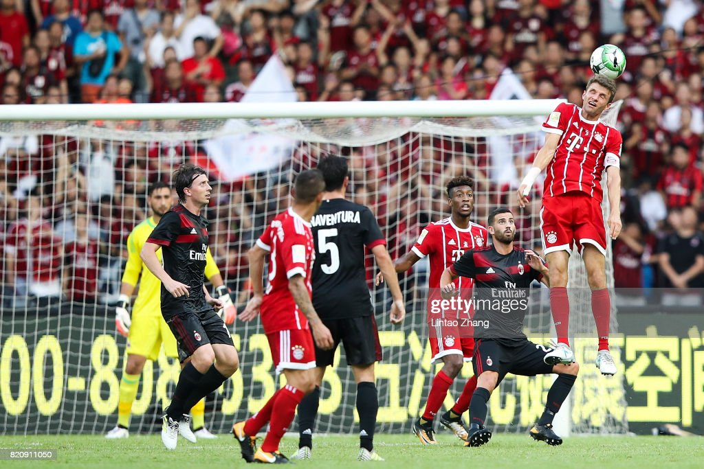 Thomas Mueller (R) of Muenchen in action on during the 2017 International Champions Cup China match between FC Bayern and AC Milan at Universiade Sports Centre Stadium on July 22, 2017 in Shenzhen, China.