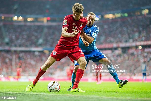 Thomas Mueller of Muenchen is challenged by Marcelo Diaz Marcelo Diaz of Hamburg during the Bundesliga match between FC Bayern Muenchen and Hamburger...
