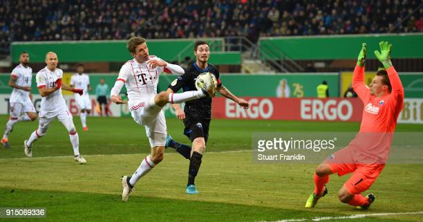 Thomas Mueller of Muenchen is challenged by Michael Ratajczak of Bielefeld during the DFB Pokal quater final match between SC Paderborn and Bayern...