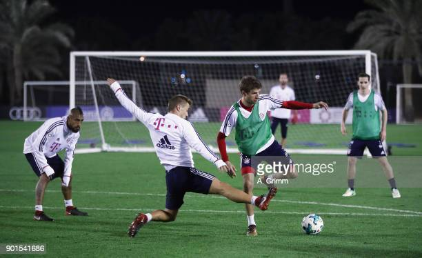 Thomas Mueller of Muenchen is challenged by RonThorben Hoffmann during a training session on day 4 of the FC Bayern Muenchen training camp at ASPIRE...