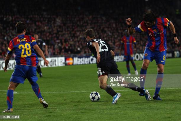 Thomas Mueller of Muenchen is fouled for a penalty by Benjamin Huggel of Basel during the UEFA Champions League group E match between FC Basel and FC...