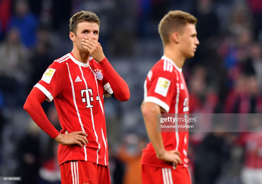 Thomas Mueller (L) of Muenchen looks dejected after the Bundesliga match between FC Bayern Muenchen and VfL Wolfsburg at Allianz Arena on September 22, 2017 in Munich, Germany.