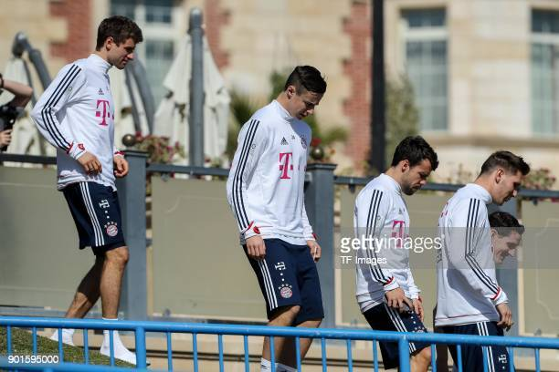 Thomas Mueller of Muenchen Marco Friedl of Muenchen Juan Bernat of Muenchen and Niklas Suele of Muenchen walk during the FC Bayern Muenchen training...