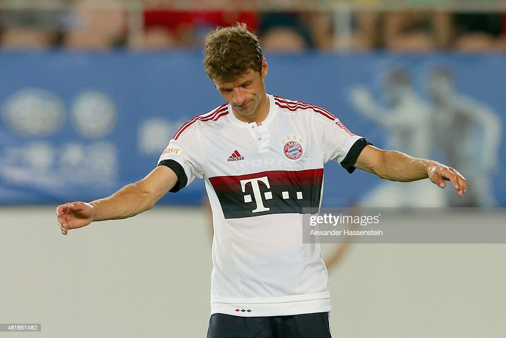 Thomas Mueller of Muenchen reacts after missed a goal at the penalty shot out of the international friendly match between FC Guangzhou Evergrande Taobao FC and FC Bayern Muenchen of the Volkswagen Cup Guangzhou at Tianhe Stadium on July 23, 2015 in Guangzhou, China.