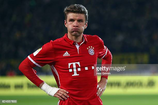 Thomas Mueller of Muenchen reacts after the Bundesliga match between Borussia Dortmund and Bayern Muenchen at Signal Iduna Park on November 19, 2016...