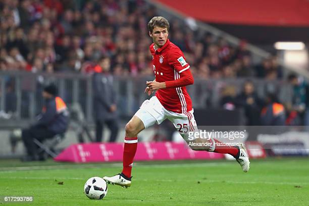 Thomas Mueller of Muenchen runs with the ball during the Bundesliga match between Bayern Muenchen and Borussia Moenchengladbach at Allianz Arena on...