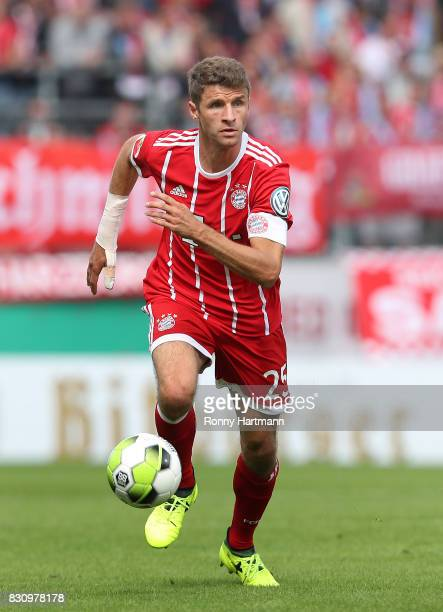 Thomas Mueller of Muenchen runs with the ball during the DFB Cup first round match between Chemnitzer FC and FC Bayern Muenchen at community4you...