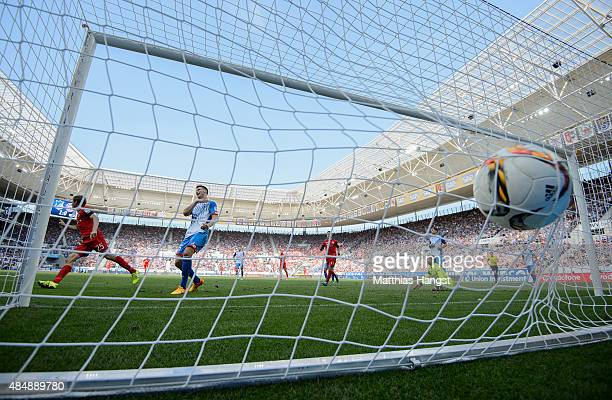 Thomas Mueller of Muenchen scores his team's first goal past goalkeeper Oliver Baumann of Hoffenheim during the Bundesliga match between 1899...