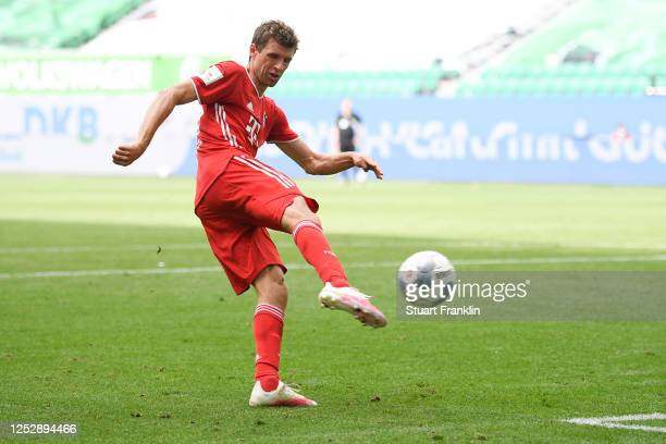 Thomas Mueller of Muenchen scores his team's fourth goal during the Bundesliga match between VfL Wolfsburg and FC Bayern Muenchen at Volkswagen Arena...
