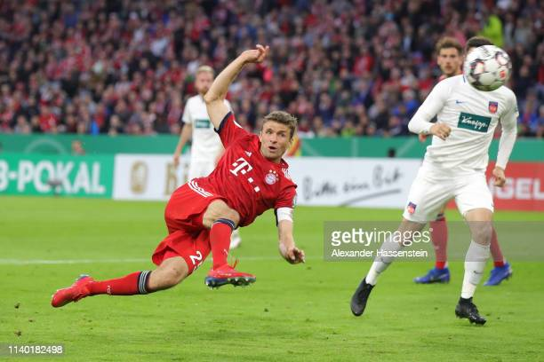 Thomas Mueller of Muenchen scores his team's second goal during the DFB Cup quarterfinal match between Bayern Muenchen and 1 FC Heidenheim at Allianz...