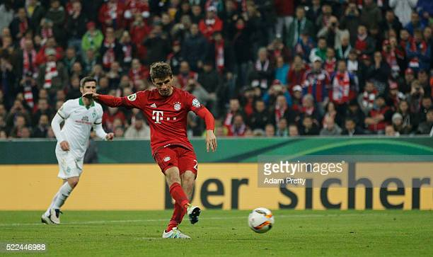 Thomas Mueller of Muenchen scores his teams second goal during the DFB Cup semi final match between FC Bayern Muenchen and Werder Bremen at Allianz...