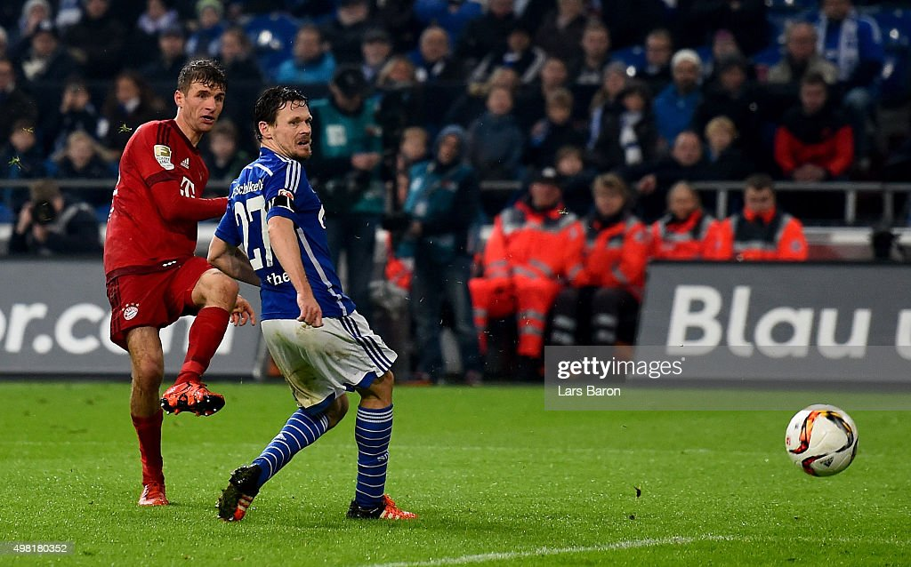 Thomas Mueller of Muenchen scores his teams third goal during the Bundesliga match between FC Schalke 04 and FC Bayern Muenchen at Veltins-Arena on November 21, 2015 in Gelsenkirchen, Germany.