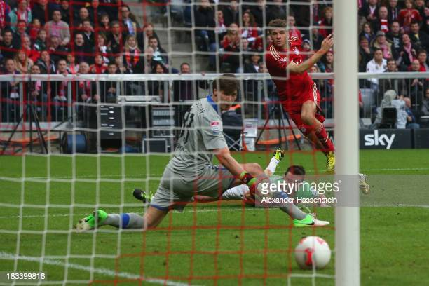 Thomas Mueller of Muenchen scores the first team goal against Fabian Giefer keeper of Duesseldorf during the Bundesliga match between FC Bayern...