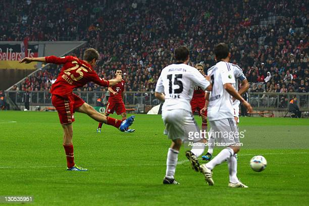 Thomas Mueller of Muenchen scores the opening goal during the DFB Cup second round match between FC Bayern Muenchen and FC Ingolstadt at Allianz...