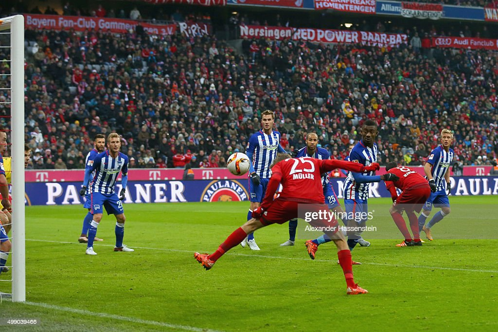 Thomas Mueller of Muenchen scores the opening goal during the Bundesliga match between FC Bayern Muenchen and Herha BSC Berlin at Allianz Arena on November 28, 2015 in Munich, Germany.