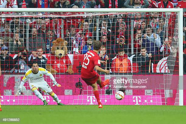 Thomas Mueller of Muenchen scores the second team goal with a penalty against Roman Buerki keeper of Dortmund during the Bundesliga match between FC...