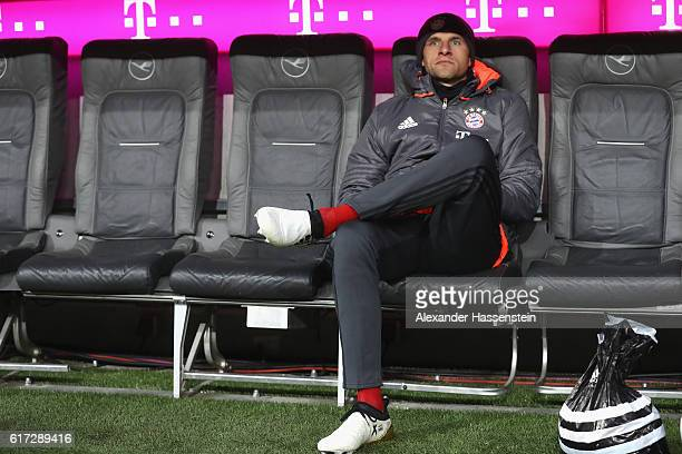Thomas Mueller of Muenchen take place on the team bench for the Bundesliga match between Bayern Muenchen and Borussia Moenchengladbach at Allianz...