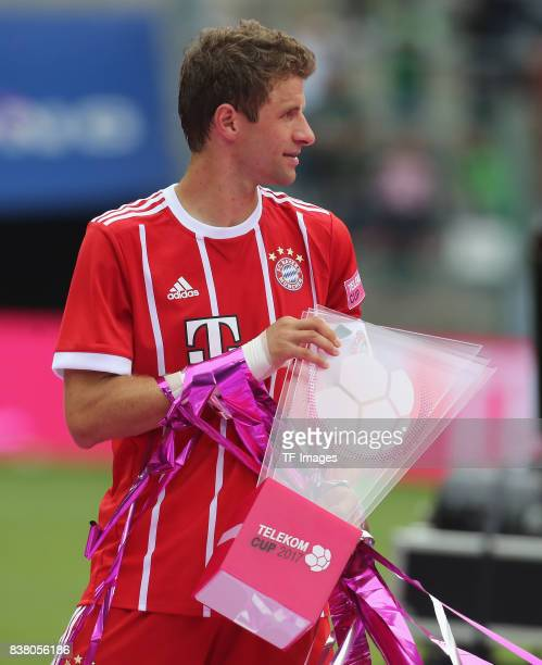 Thomas Mueller of Muenchen with the Telekom cup during the Telekom Cup 2017 Final between SV Werder Bremen and FC Bayern Muenchen at Borussia Park on...