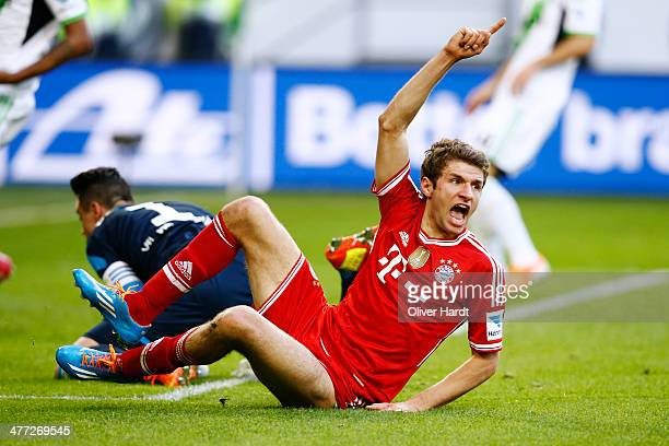 Thomas Mueller of Munich celebrates after scoring their second goal during the Bundesliga match between VfL Wolfsburg and FC Bayern Muenchen at...
