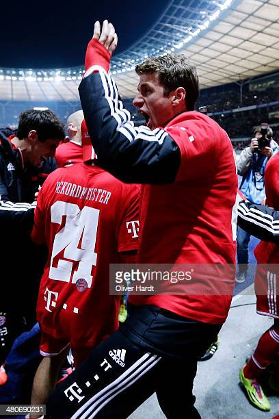 Thomas Mueller of Munich celebrates after the Bundesliga match between and Hertha BSC and FC Bayern Muenchen at Olympiastadion on March 25 2014 in...