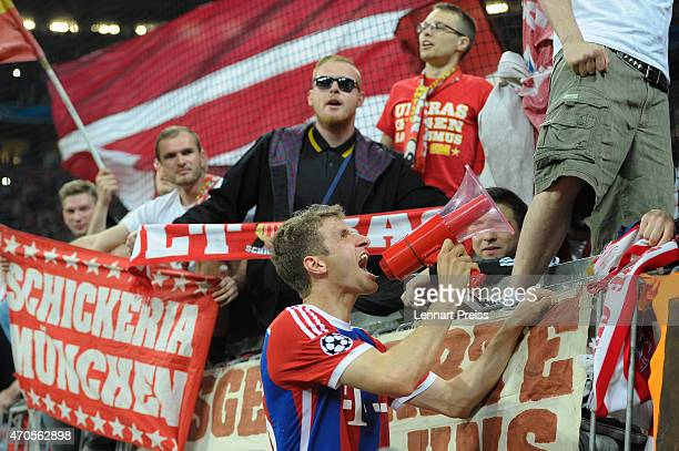 Thomas Mueller of Munich celebrates with the fans after the UEFA Champions League quarter final second leg match between FC Bayern Muenchen and FC...